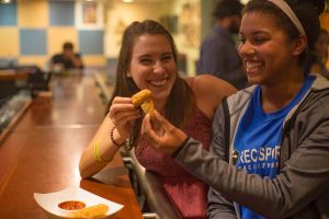 a photo of two girls eating mozzarella sticks in McPhail's