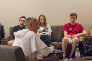 Photo of Dominican priest speaking in a room with students