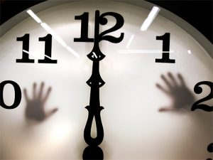 Clock at midnight with hands trapped behind it