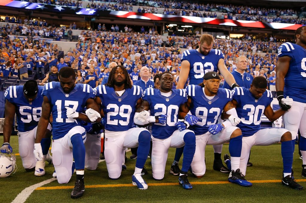 NFL players taking a knee during the national anthem.