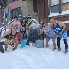 A group of residents from St. Joseph Hall at Providence College underdressed in shorts and shirts for the winter storm