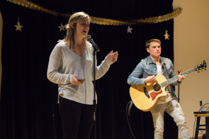 A member of the A capella group, Anaclastic (left), and Adam Hanna '18 (botton) preform their songs at SNL Night.