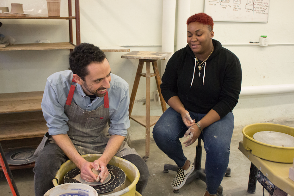 A Providence College professor and student collaborating in an independent study.
