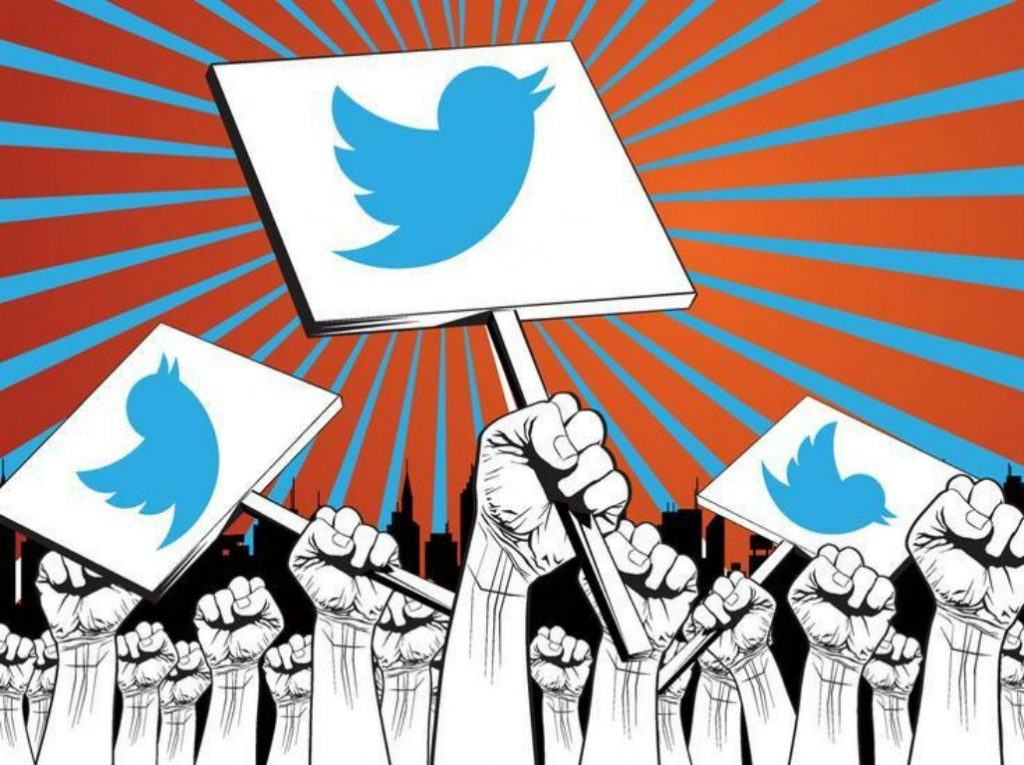 Graphic of hands holding up signs with the Twitter logo on them.