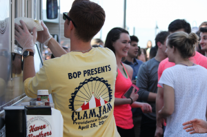 A member of Providence College's BOP serves food from Haven Brothers at Clam Jam.