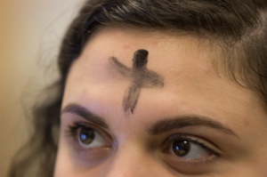 Ashes on a girl's forehead for Ash Wednesday