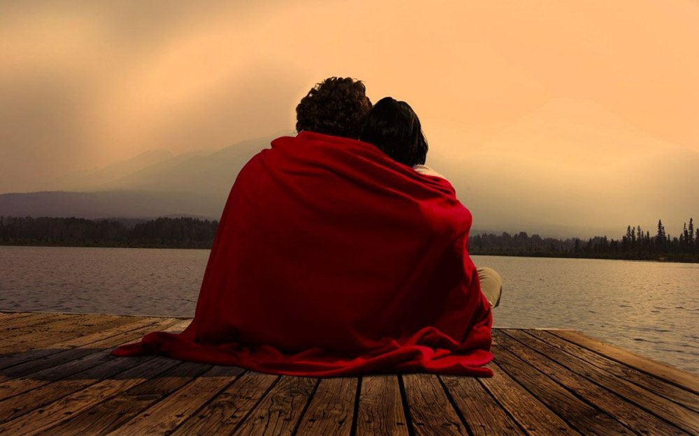 Two people with a blanket