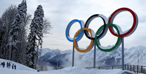 Olympic rings with a snowy background