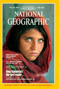The iconic photo of a 12 year old girl in a refugee camp in Pakistan, shot by Steve McCurry for National Geographic