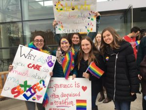 PC students holding signs in support of the LGBTQ+ community