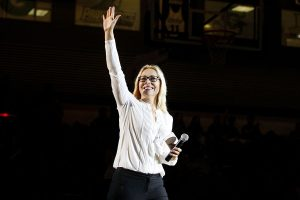 Doris Burke waves to the Providence College crowd during late night madness.