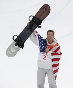 Shaun White celebrates after winning his third gold medal.