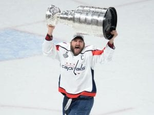 alex ovechkin hoists the stanley cup for the first time