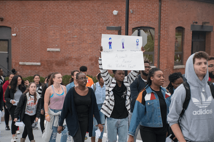 A group of students march for sexual assault victims.