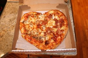 Heart-shaped pizza in a box