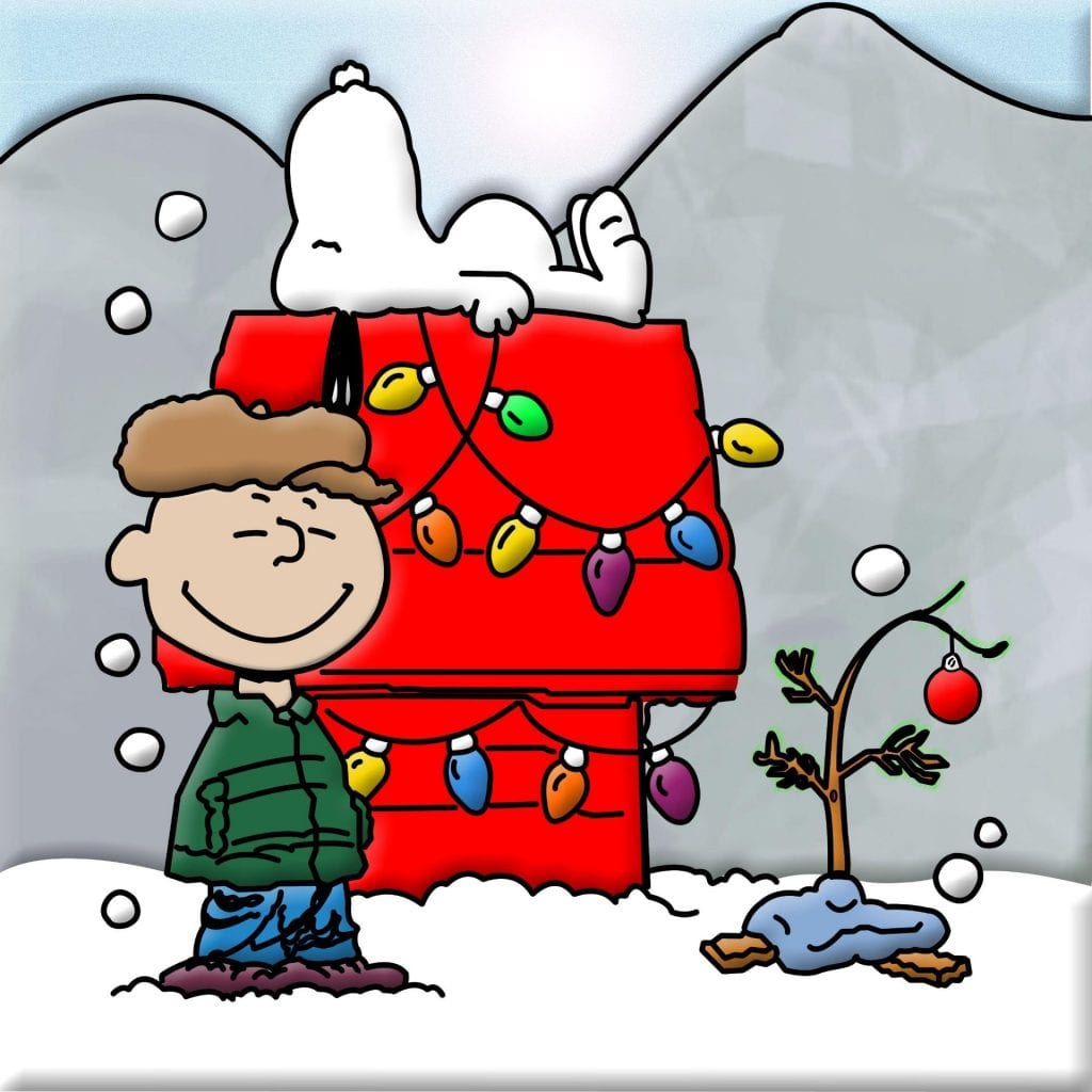 Charlie brown with his Christmas tree by Snoopy and his doghouse