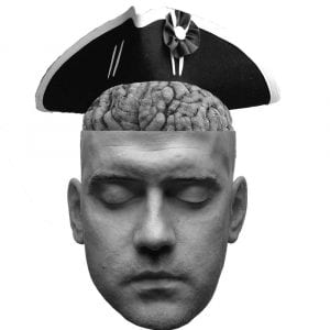 A head having its brain replaced with another wearing a Revolutionary War hat