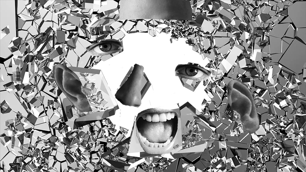 Parts of a face on falling broken glass