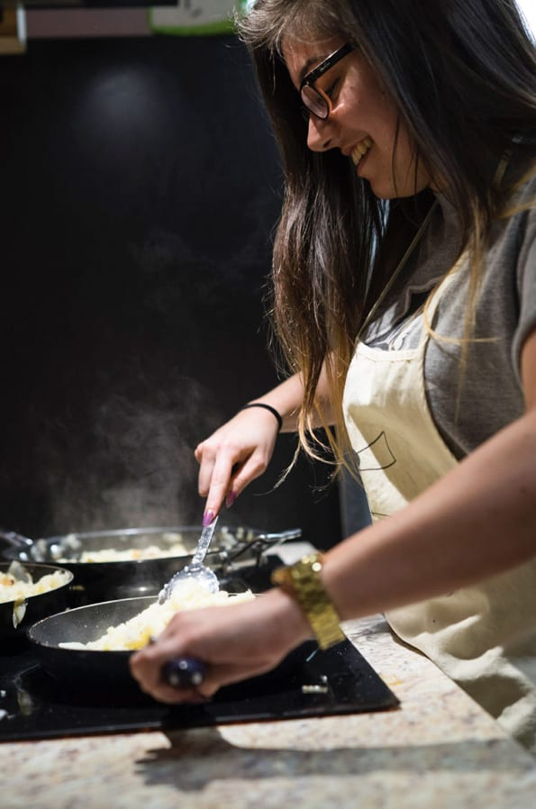 Photo of student cooking.