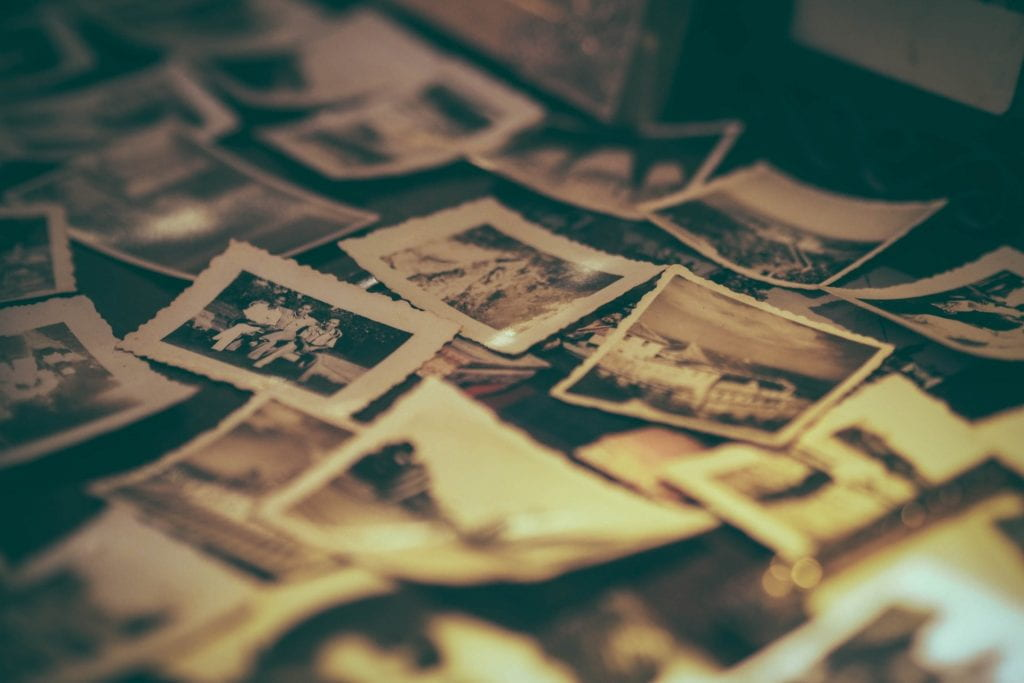 A bunch of old photographs in a pile