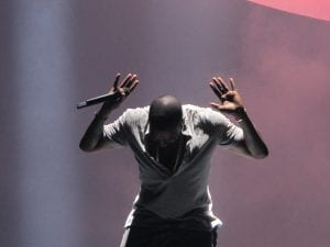 Kanye West hands raised in concert