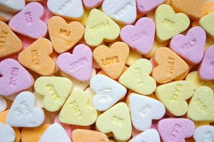 Candy hearts in a pile