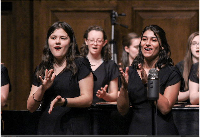 Fall Chorus Concert two female singers clapping