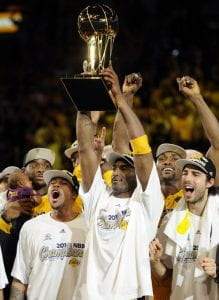 Bryant lifts the Larry O'Brien Trophy in 2010