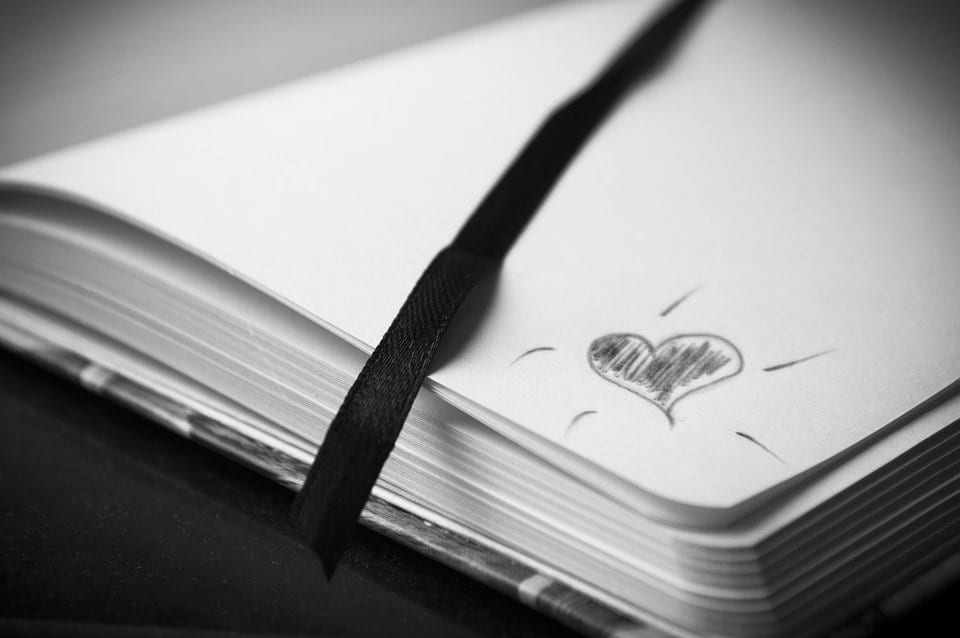 A little heart drawn on a poetry book