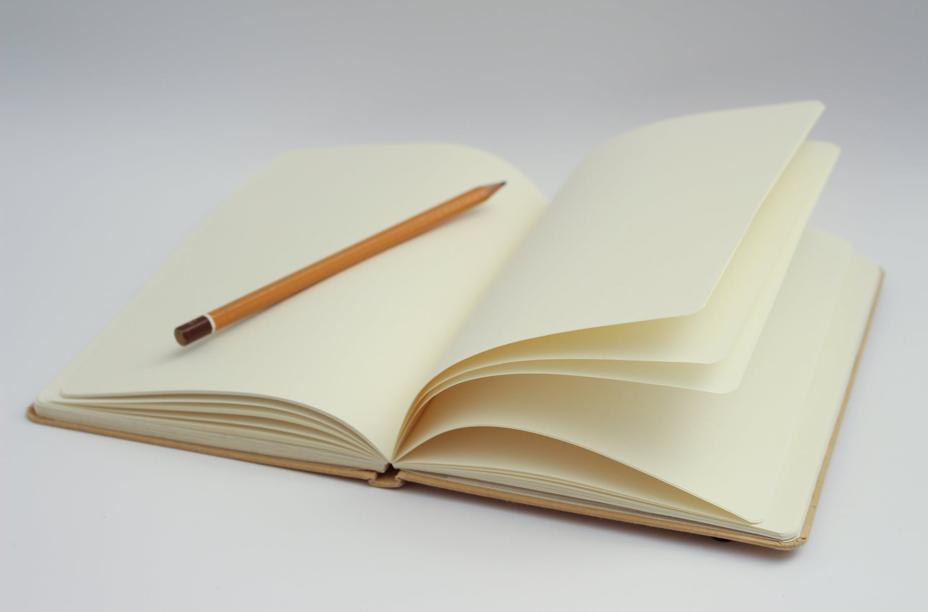 A pencil laying flat on a journal