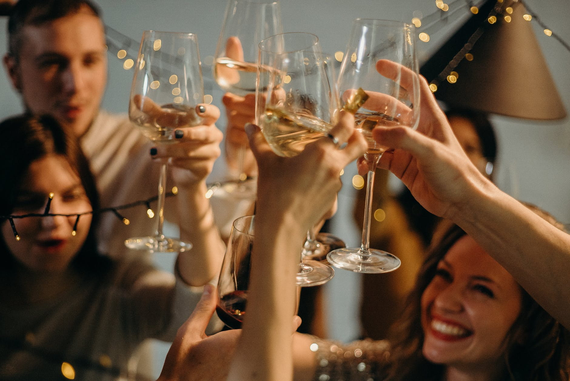 People raising their champagne glass in a toast