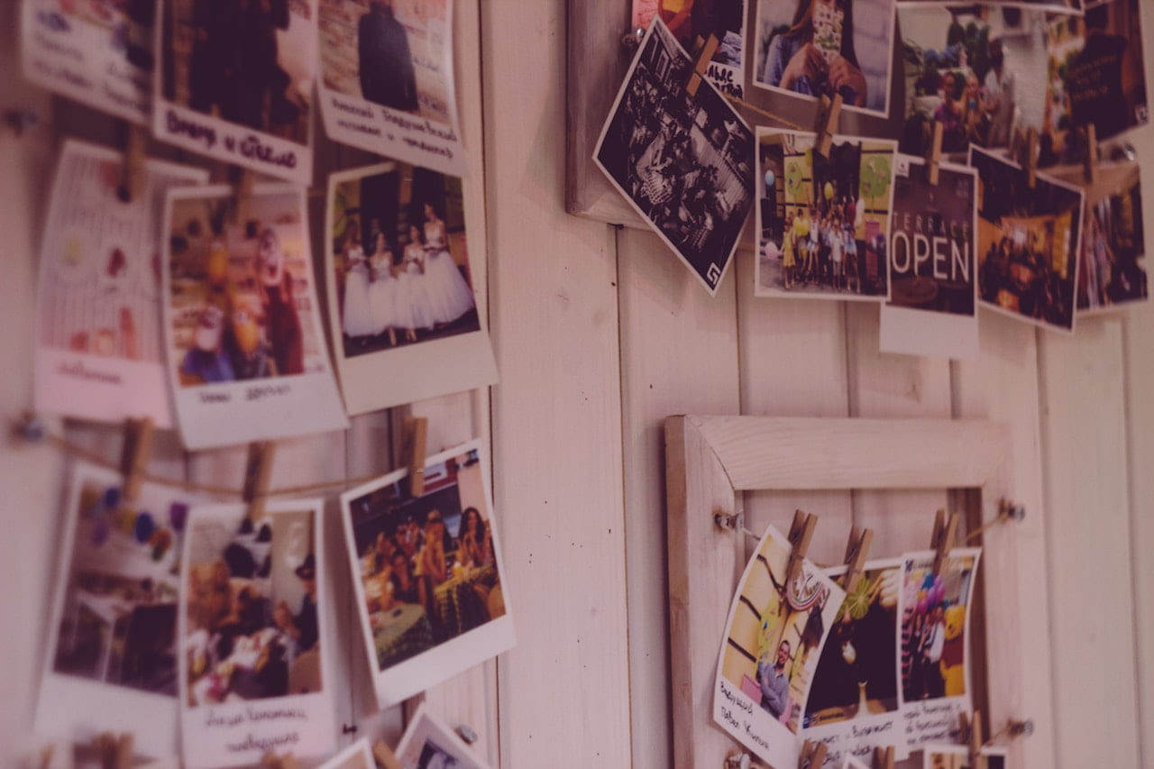 Wall covered in polaroid photos