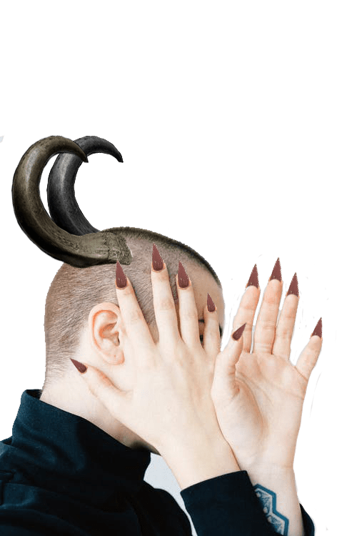 Man with horns on head covering face with hands