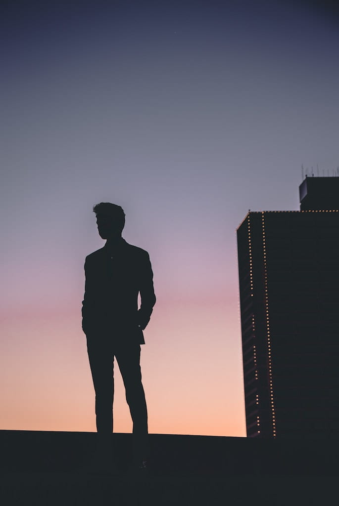 man looking into the evening sky