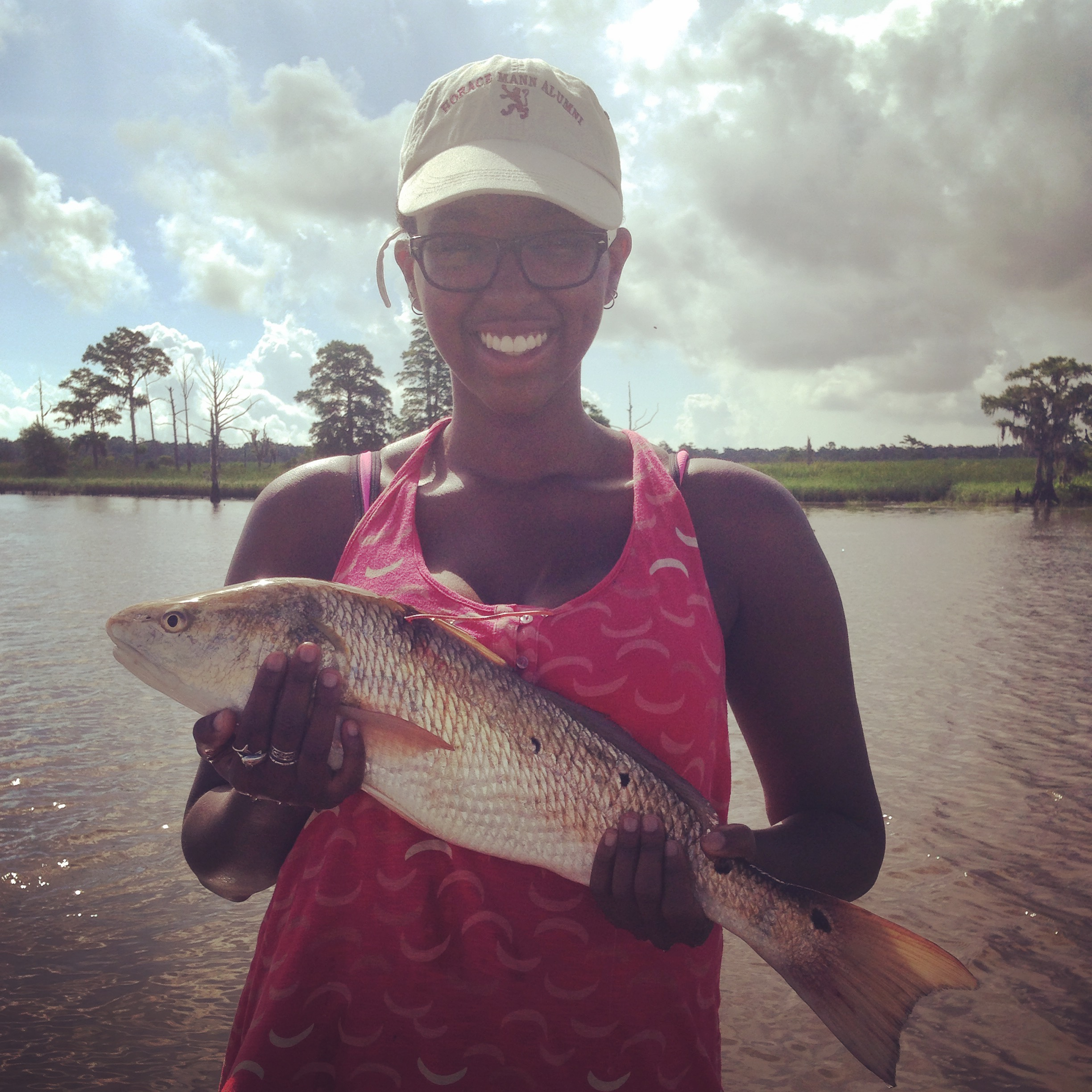 Me in Winyah Bay, South Carolina holding a wild Red drum (my focal species for the summer)