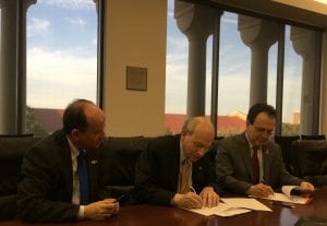 From left, Prof.Dr. Ing Benedito G. Aguilar Neto, provost of Universidade Presbiteriana Mackenzie, Rice University President David Leebrom, and Dr. Mauricio Melo de Meneses signing a MOU.