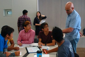 Students receive input from CS professor Luay Nakhleh