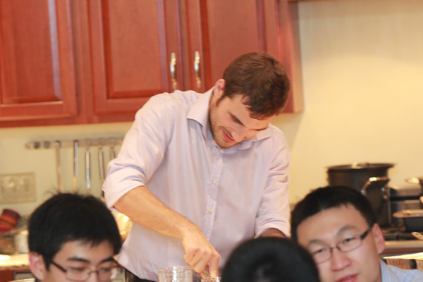 Michele working in the Kitchen, Zixing Zin and Xiao Liu waiting….