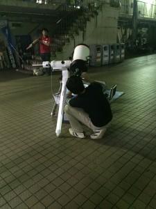Kento-san sets his telescope to point toward Saturn. ~ Daniel Gilmore