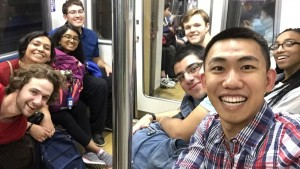 Riding the Tokyo Metro: In which I look way too excited that the eight of us managed to get seats exactly in the eight-person section of the car, on a crowded train in Tokyo. - Haihao Liu