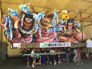 On three, heave!: One of the many giant, colorful Nebuta Matsuri floats, made by hand every year, that Aomori is most famous for. ~ Haihao Liu