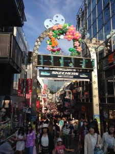 Takeshita Street: This weekend I visited Harajuku and got to see the bustling shops and restaurants on Takeshita street. It might be hard to see, but that's me on the screen! - Chandni Rana