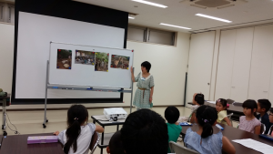 Volunteering at the Toyonaka Community Environment Center (豊中市立環境交流センター). We explored the topic of fair trade with kodomo (1st to 3rd grade children). Although the children spoke better Japanese than me, we still managed to have a fun time and somehow communication worked out! Although I wasn't quite sure how to get this one Japanese girl to not climb on me. ~ Donald Swen