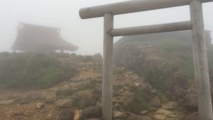 The entire top of the mountain had been enveloped by a large cloud while I was up there. As a walked along the peak, this shrine suddenly emerged from the fog. Extremely quiet and completely surrounded by fog, this shrine stood in a very unique environment. ~ Youssef Tobah