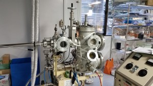 Electron Beam Evaporation: This was the machine I used to create my gold electrodes. After a lot of knob turning, vacuum creation, and button pushing, this machine used a stream of electrons to evaporate gold which then collected on my sample. - Nickolas Walling