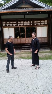 Donning the Yukata: We were all given yukata in Kyoto! Yukata are a type of traditional Japanese clothing which look like an elegant robe with a sash tied around the middle. In this picture I'm getting a modelling lesson from the photographer. ~ Nickolas Walling