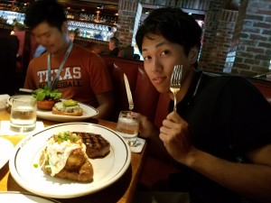 Restaurant with lab members. At the restaurant, I am eating a beef steak. That is very big and taste good! ~ Hiromi Miwa