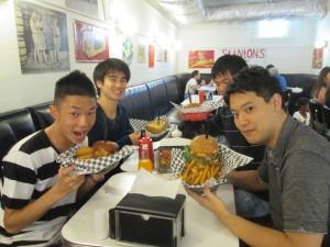 Eating the stereotypical American hamburger. ~ Soya Miyoshi