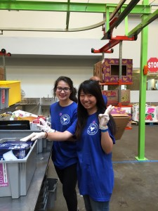 At the Houston Food Bank with another freshman student. ~ Yunong Wang
