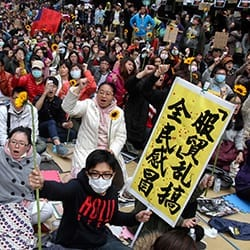 The largest student-led protest in Taiwan's history saw more than 350,000 people march against a trade agreement with China.